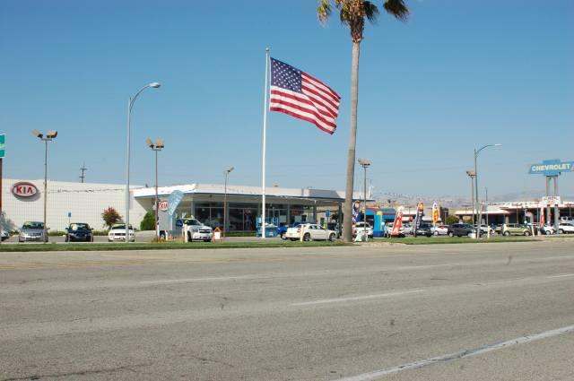 Kia Dealer, Chevy Pole Sign