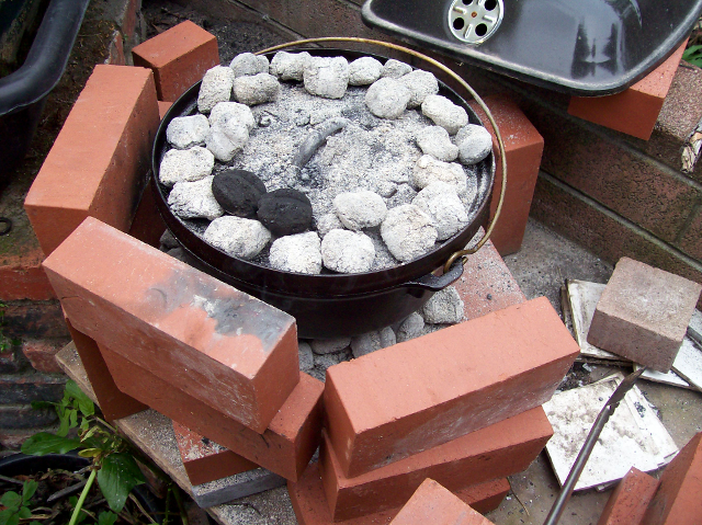 Dutch Oven in the Pile Of Bricks surround and base.