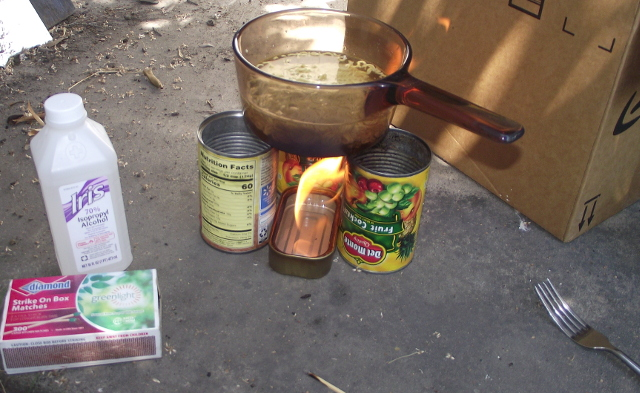 4 empty cans stove